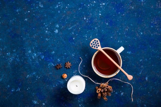 Hot autumn drink on a dark blue