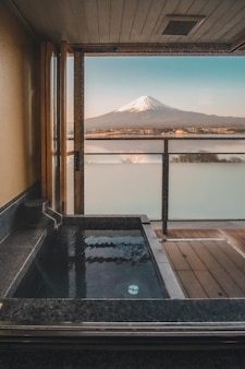 Hot bath japanese onsen in traditional ryokan resort with beautiful mt.fuji view background