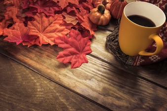 Hot beverage and red maple leaves composition