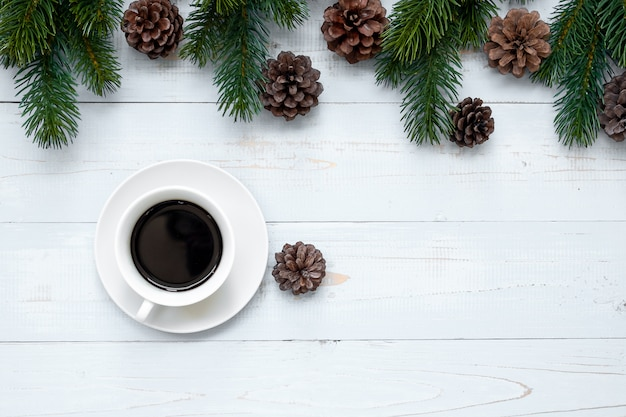 Hot  black coffee cup with christmas decoration, happy new year and xmas holidays