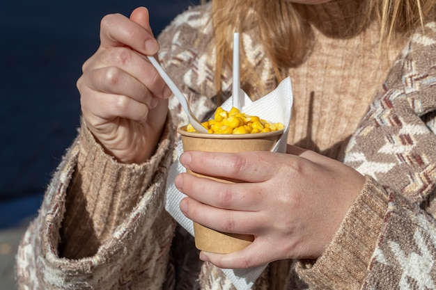 Hot boiled corn fresh, fast, tasty and healthy meal in paper glass.
