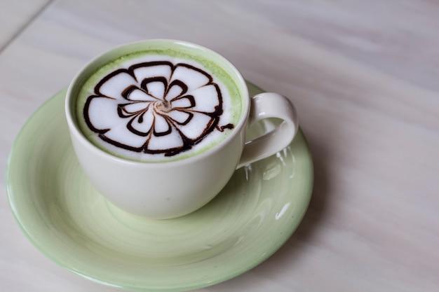 Hot cappuccino in white ceramic cup