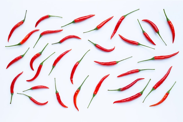 Hot chili peppers on white surface. top view