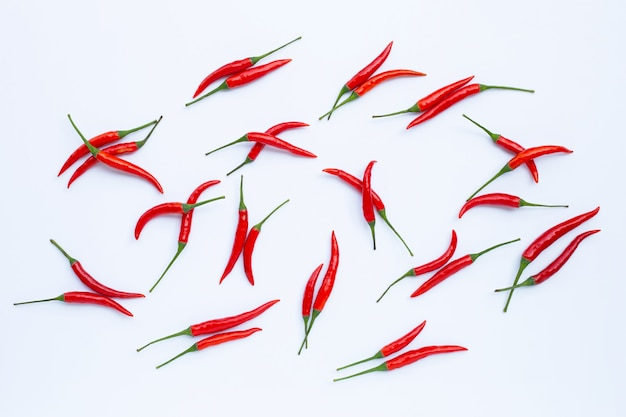Hot chili peppers on white surface