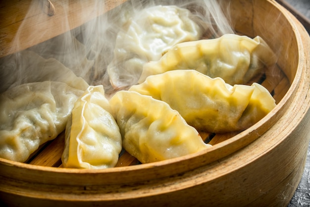 Hot chinese dumplings gedza in the steamer. traditional dish