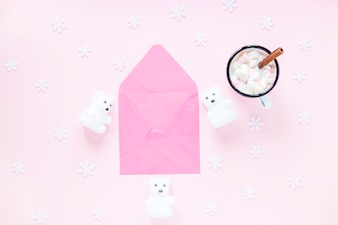 Hot chocolate and snowflakes near envelope and bears