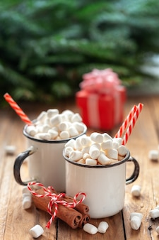 Hot chocolate cocoa with marshmallow in white ceramic mugs