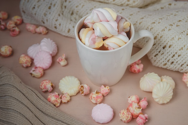 Hot chocolate drink with marshmallow and popcorn
