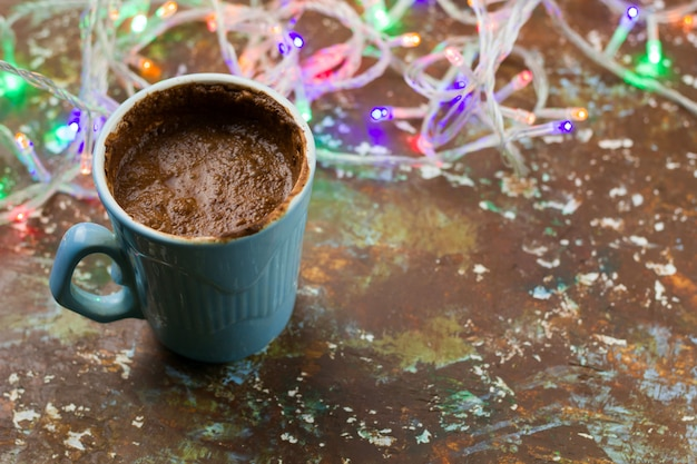 Hot chocolate and garland lights  on the table
