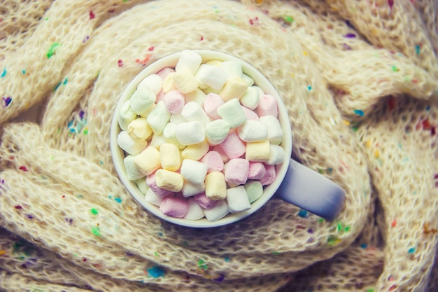Hot chocolate and marshmallow on christmas background. selective focus.