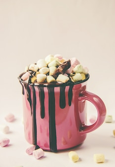 Hot chocolate and marshmallow on christmas background