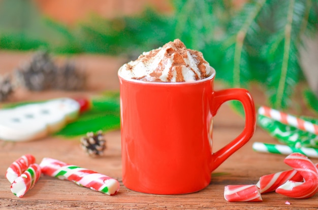 Hot chocolate in a mug with whipped cream. winter time treat