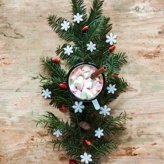 Hot chocolate on spruce twig