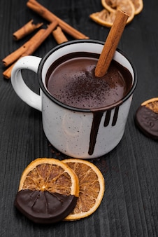 Hot chocolate with cinnamon stick and dried orange slices