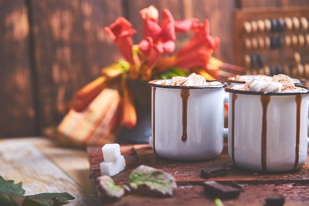 Hot chocolate with marshmallow candies on wooden.