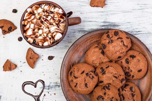 Hot chocolate with marshmallow and chocolate cookies,