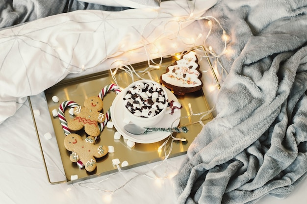 Hot chocolate with marshmallow, gingerbread man and cookies