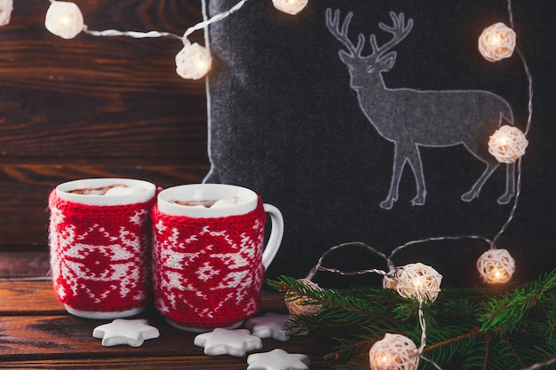 Hot chocolate with marshmallows and biscuits on christmas decorations
