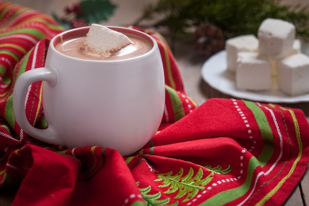 Hot chocolate with marshmallows and christmas lights decoration