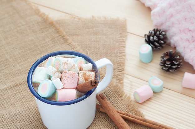 Hot chocolate with marshmallows. pastel colour. winter drink