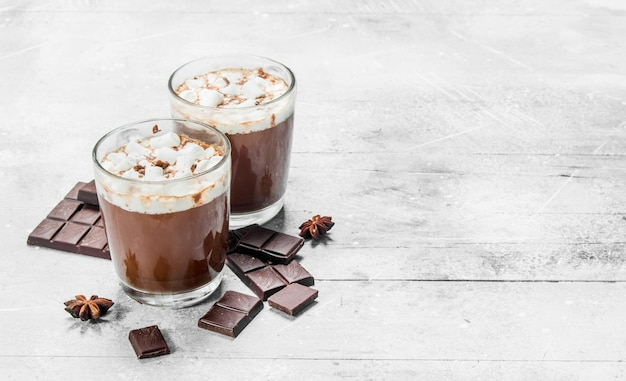 Hot chocolate with marshmallows. on a rustic table.