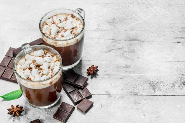 Hot chocolate with marshmallows on rustic table.