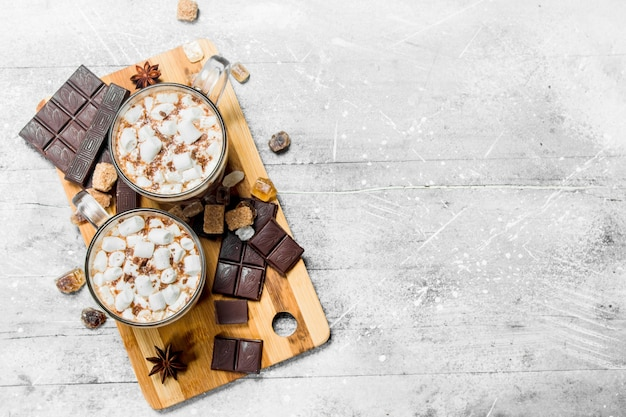 Hot chocolate with marshmallows. on a rustic.