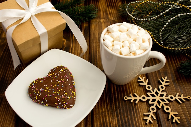 Hot chocolate with marshmallows in the white cup and christmas composition