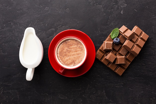 Hot chocolate with milk flat lay