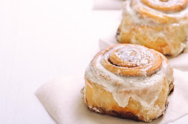 Hot cinnamon buns with sugar cream icing