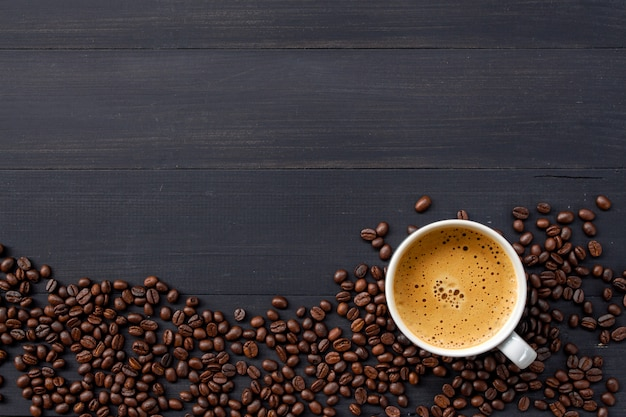 Hot coffee and bean on wooden background. top view