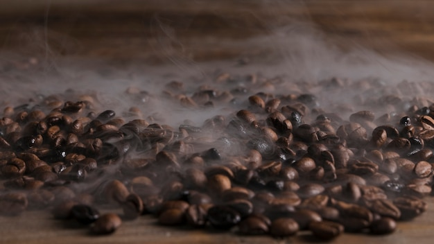 Hot coffee beans on wooden table