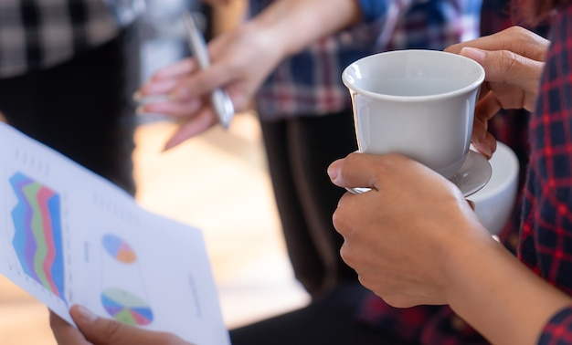 Hot coffee cup in a business start up meeting