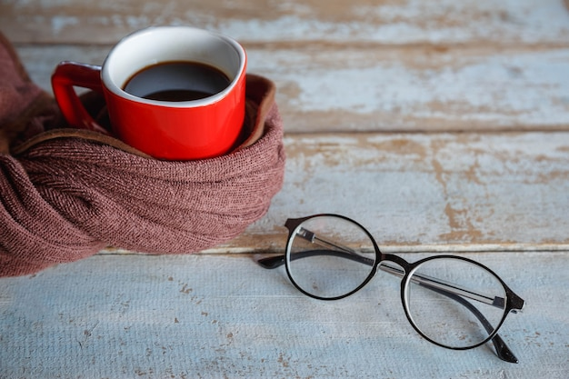 Hot coffee in red cup and scarf in winter
