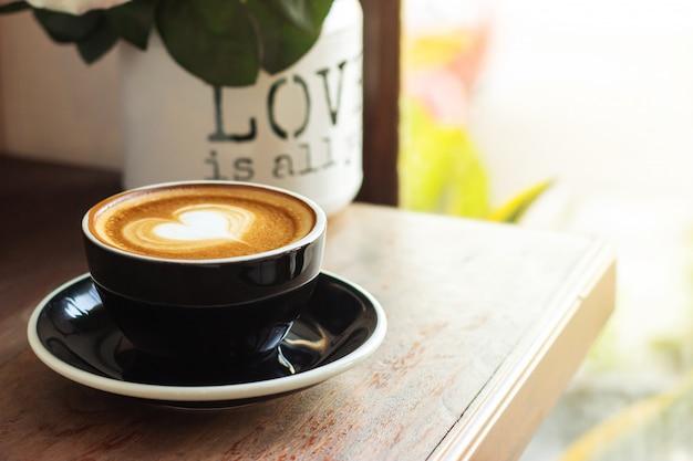 Hot coffee with art latte in heart shape.