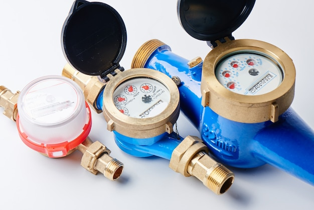 Hot and cold water meters on a white background
