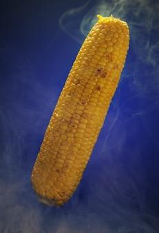 Hot corn on blue wall