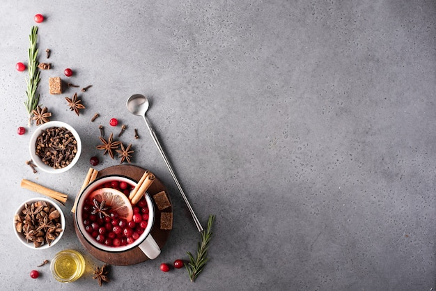 Hot cranberry tea with lemon and honey in a white mug, top view