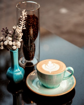Hot cup of cappuccino with froth