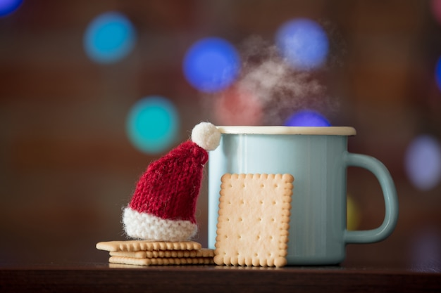 Hot cup of coffee and classic cookie, santa claus