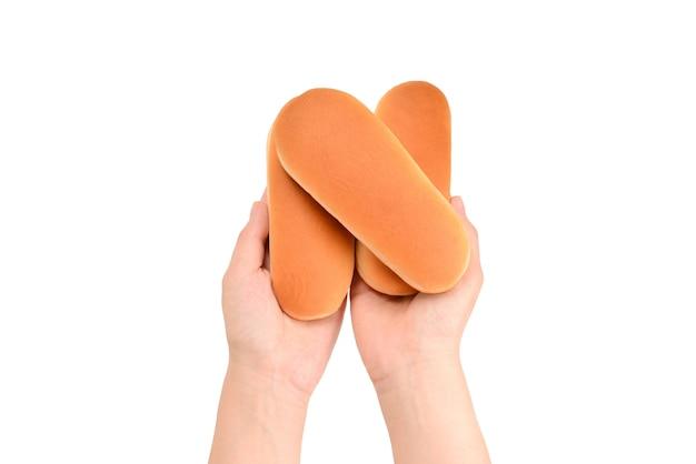 女性の手でホットドッグパン