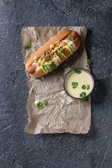 Hot dog with cheese sauce and mustard
