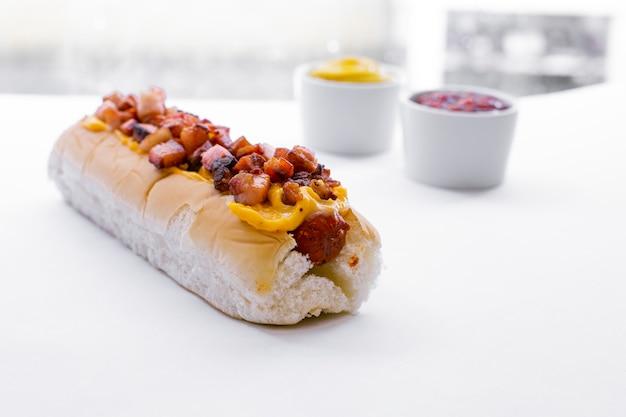 Hot dog with fast food menu with potato chips, ketchup and mayonnaise - image