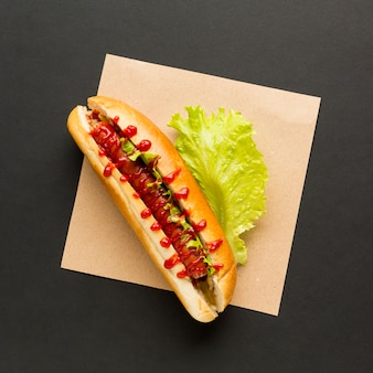Hot dog with lettuce top view