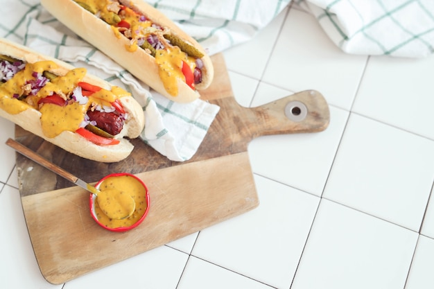 Hot dog with sauce on white surface