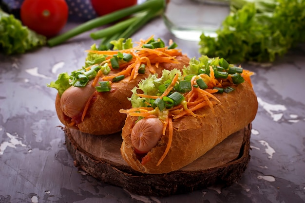 Hot dog with sausage, carrot, onion, lettuce