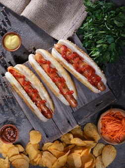Hot dogs, chips, sauces on the table