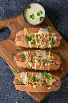 Hot dogs with cheese sauce and mustard