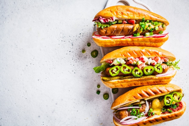 Hot dogs with different toppings
