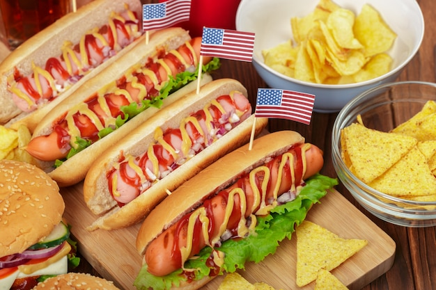 Hot dogs on wooden background